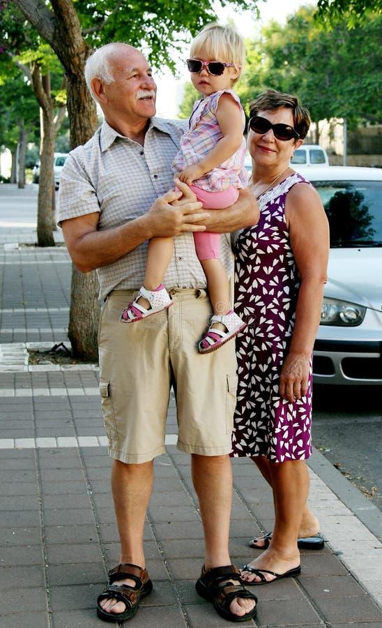 Счастливые деды с внуком стоковое фото rf