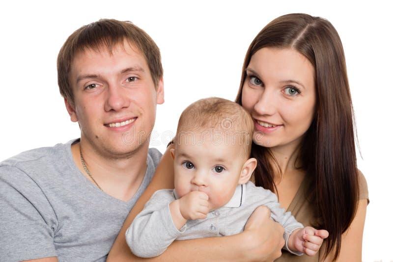 Счастливые молодые родители с их любимым сыном стоковое фото rf