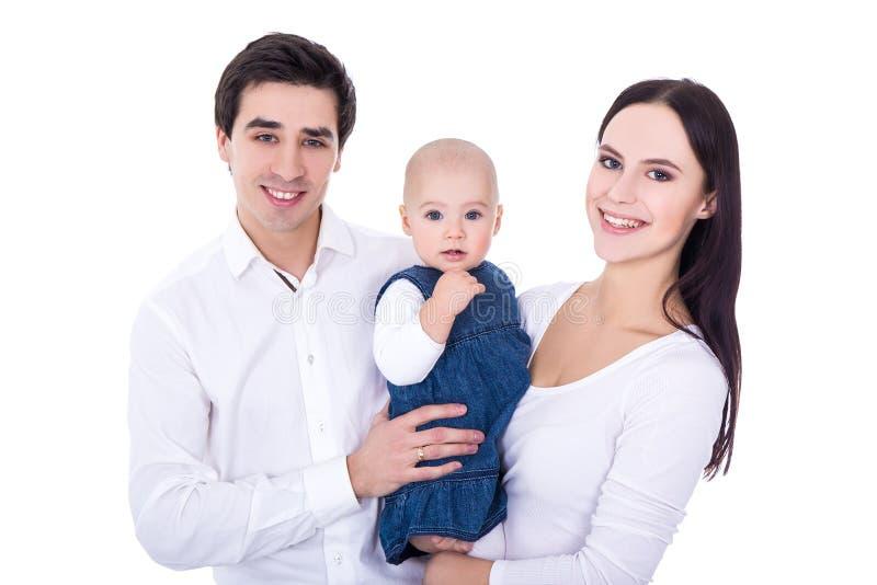 Счастливые молодые родители с маленькой дочерью на белизне стоковые фотографии rf