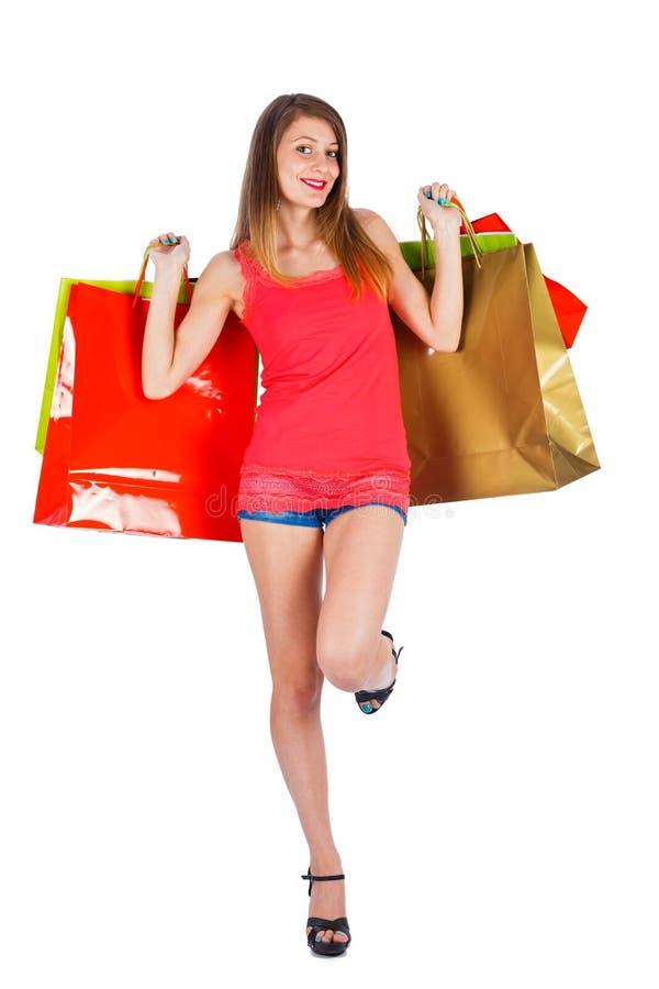Счастливые покупки женщины стоковая фотография