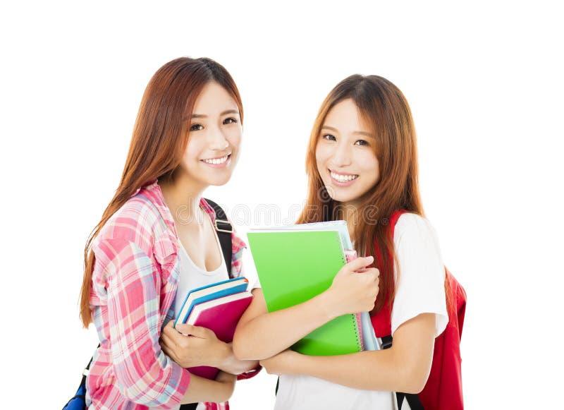 Счастливые подростковые девушки студентов изолированные на белизне стоковые фотографии rf
