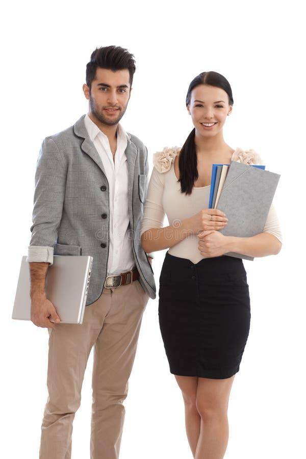 Счастливые предприниматели с файлами и компьтер-книжкой стоковое изображение rf