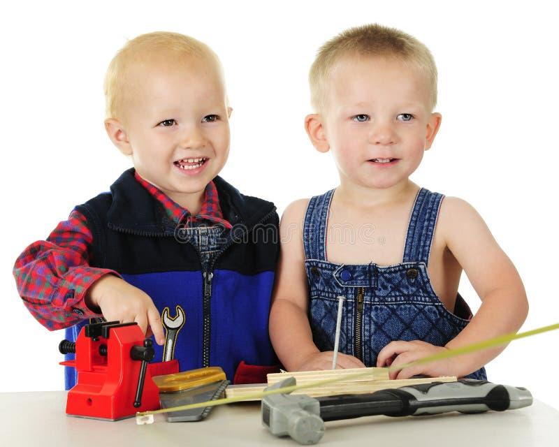 Счастливые люди инструмента малыша стоковое фото