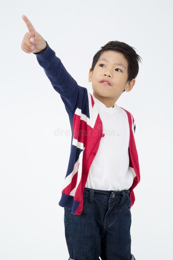 Счастливый азиатский милый мальчик с стороной улыбки стоковое фото