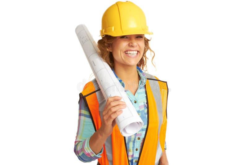 Счастливый красивый женский рабочий-строитель стоковые фотографии rf