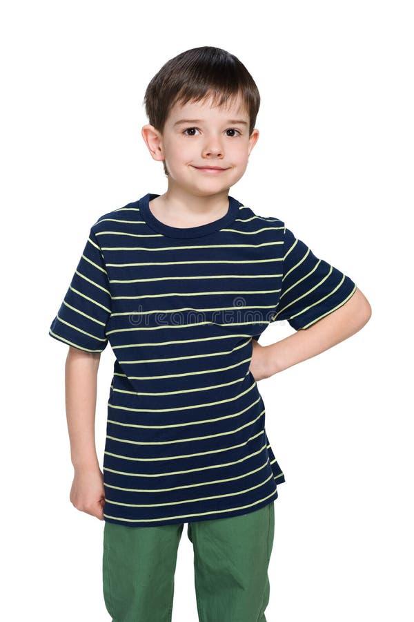 Счастливый мальчик на белой предпосылке стоковое изображение rf