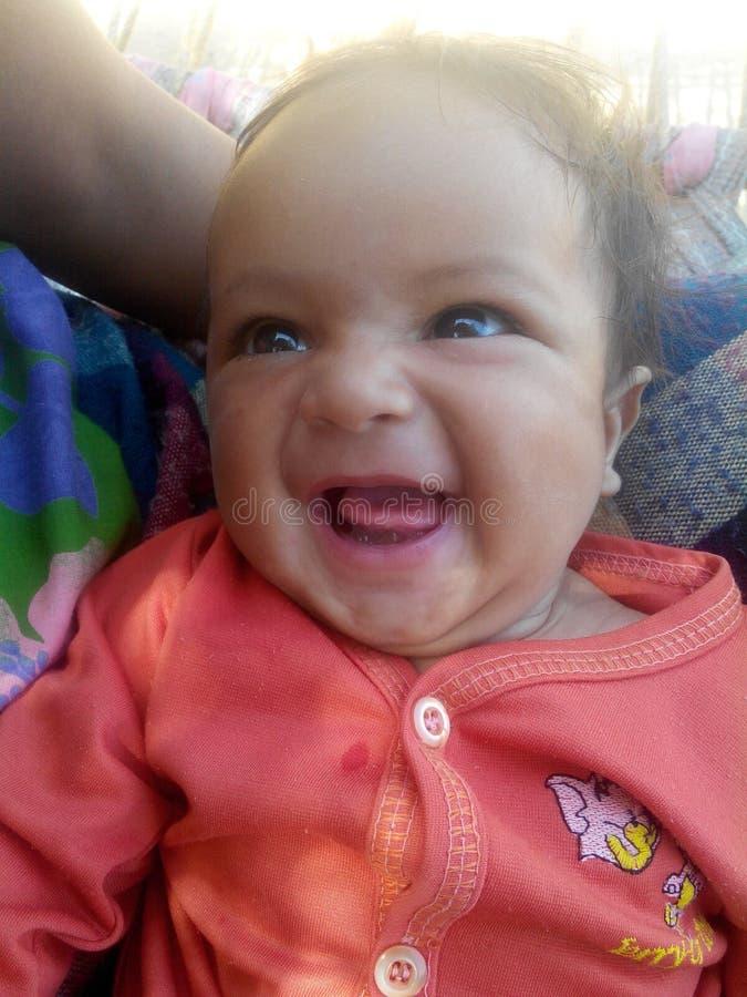 Счастливый & милый младенец стоковые изображения