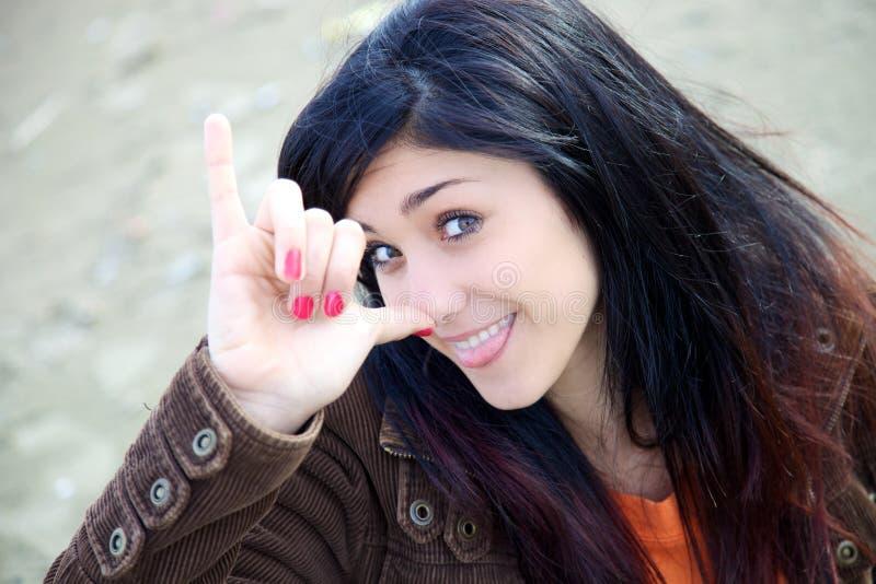 Счастливый молодой подросток делая смешную сторону стоковые изображения rf