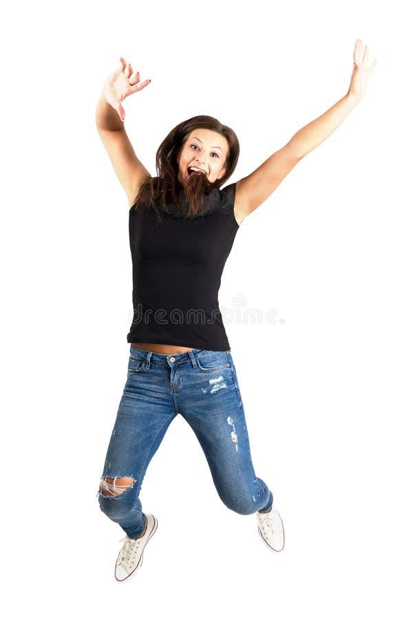 Счастливый молодой скакать красоты стоковое фото