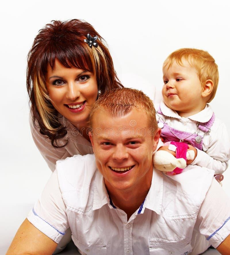 Счастливый молодой смеяться над семьи стоковое изображение