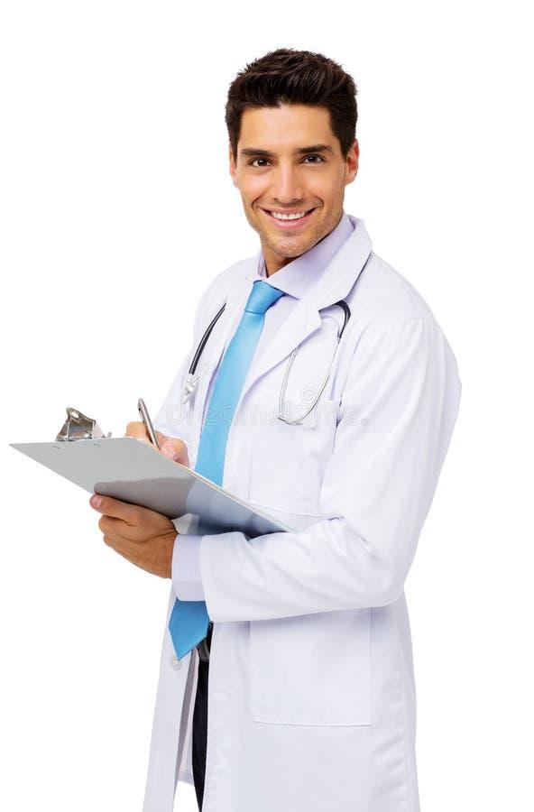Счастливый мужской доктор Сочинительство На Доска сзажимом для бумаги стоковые фото