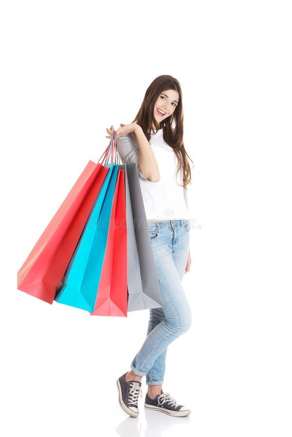 Счастливый подросток после ходить по магазинам стоковая фотография