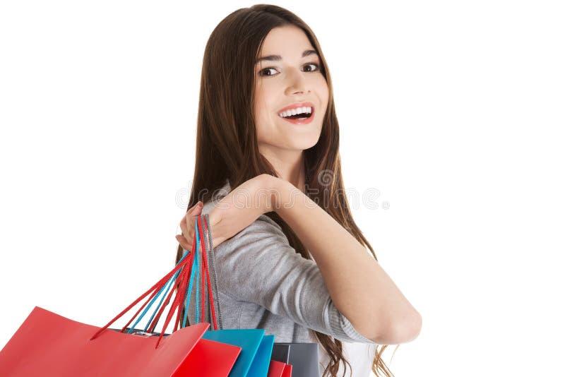 Счастливый подросток после ходить по магазинам стоковые изображения