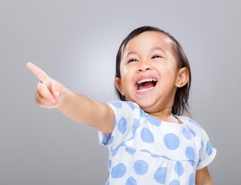 Счастливый пункт девушки вверх стоковое изображение