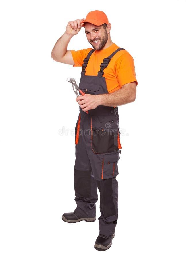 Счастливый работник с плоскогубцами стоковая фотография rf