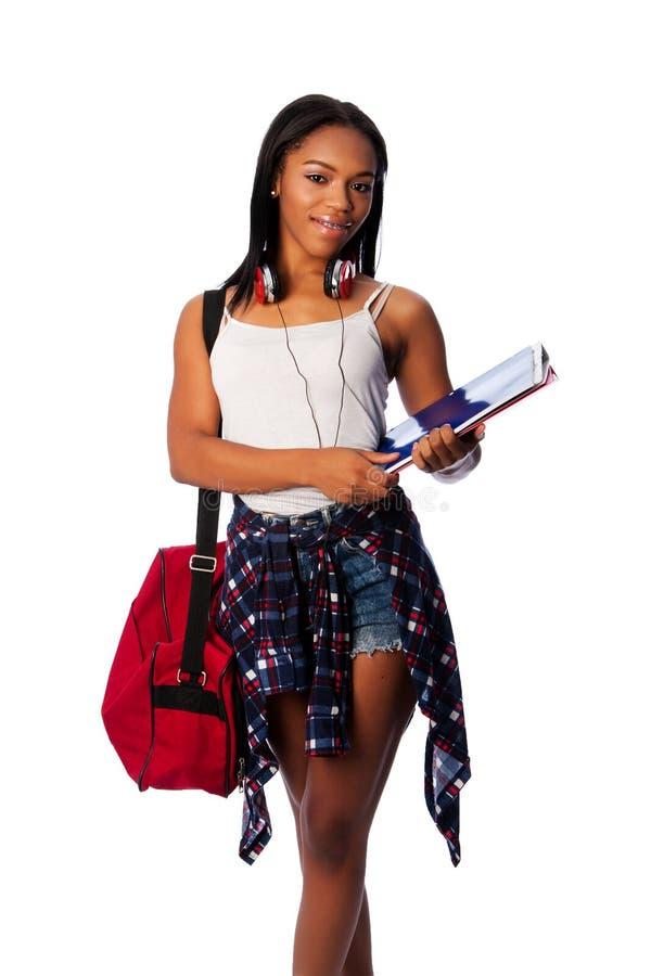 Счастливый студент с связывателями и сумкой стоковые фото