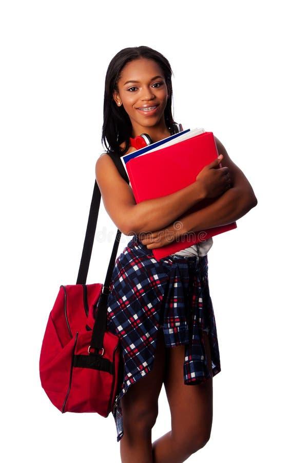 Счастливый студент с связывателями и сумкой стоковые изображения