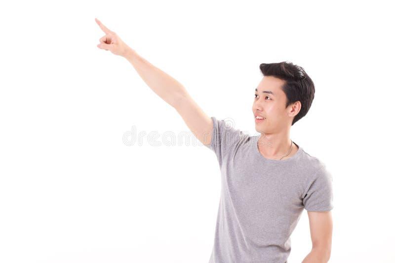 Счастливый, усмехающся, выведенный человек указывая палец вверх, изолированная белизна стоковое фото
