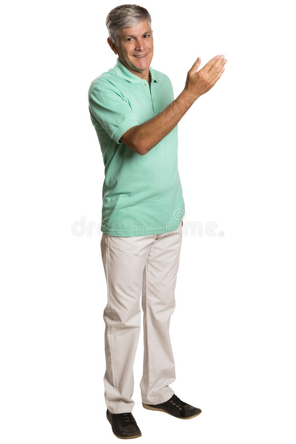 Счастливый усмехаясь молодой человек представляя и показывая ваш текст или побуждает стоковое фото