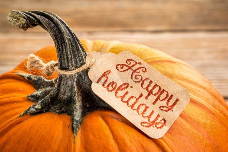 Счастливый ценник праздников на тыкве стоковые фото