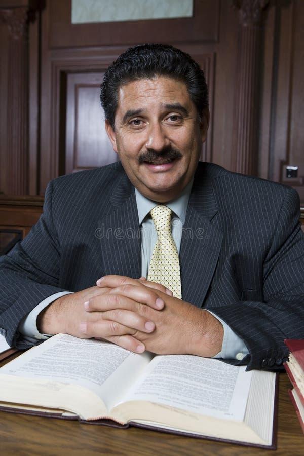 Счастливый юрист с книгой по праву стоковое изображение rf
