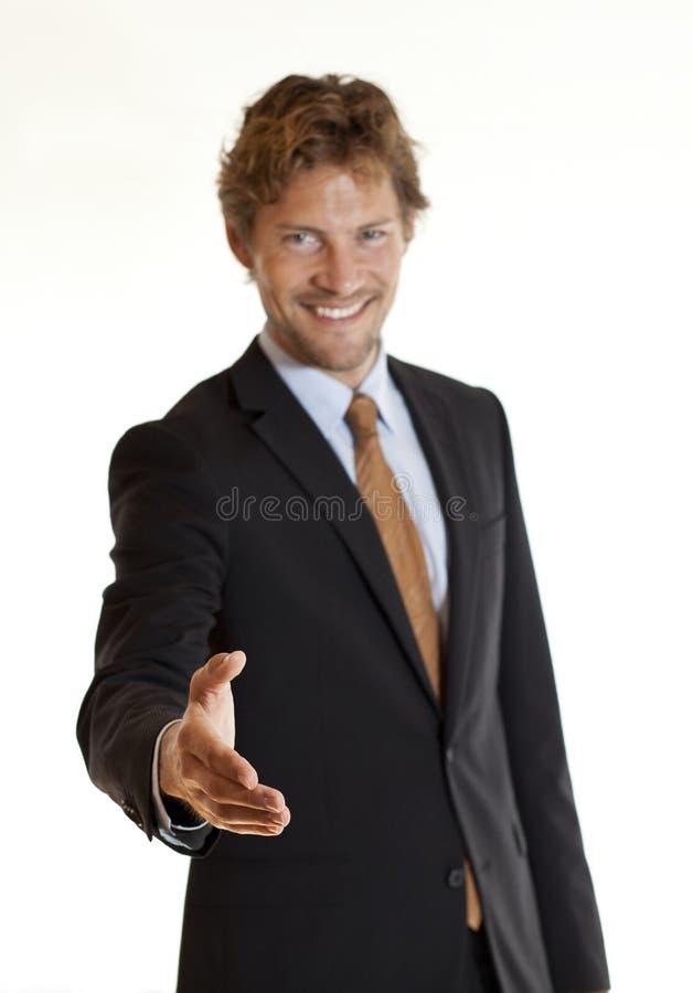 Счастливый handshaking бизнесмена стоковая фотография