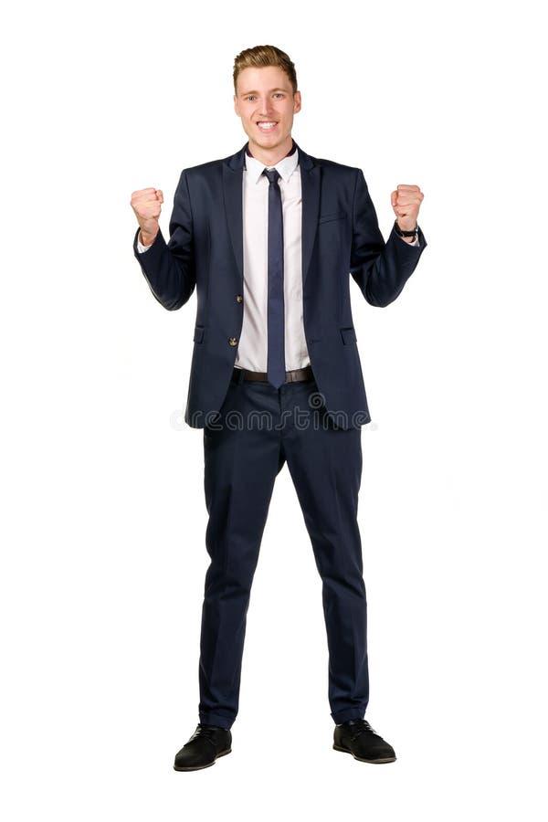 Счастливым молодым кулаки поднятые бизнесменом стоковые изображения rf