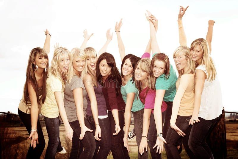 10 счастливых девушек стоковое фото rf