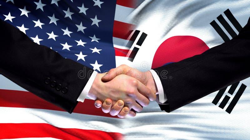 США и рукопожатие Южной Кореи, международная предпосылка флага приятельства, финансы стоковая фотография rf