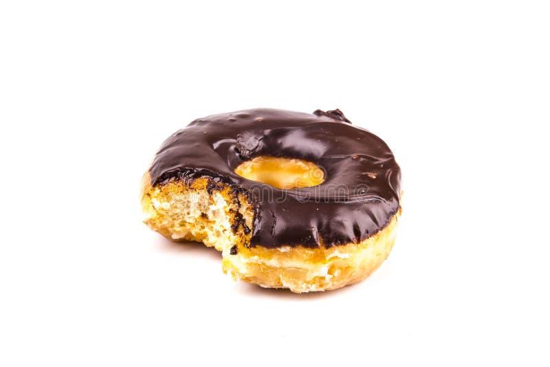 Съеденные donuts шоколада изолированные на белой предпосылке стоковое фото