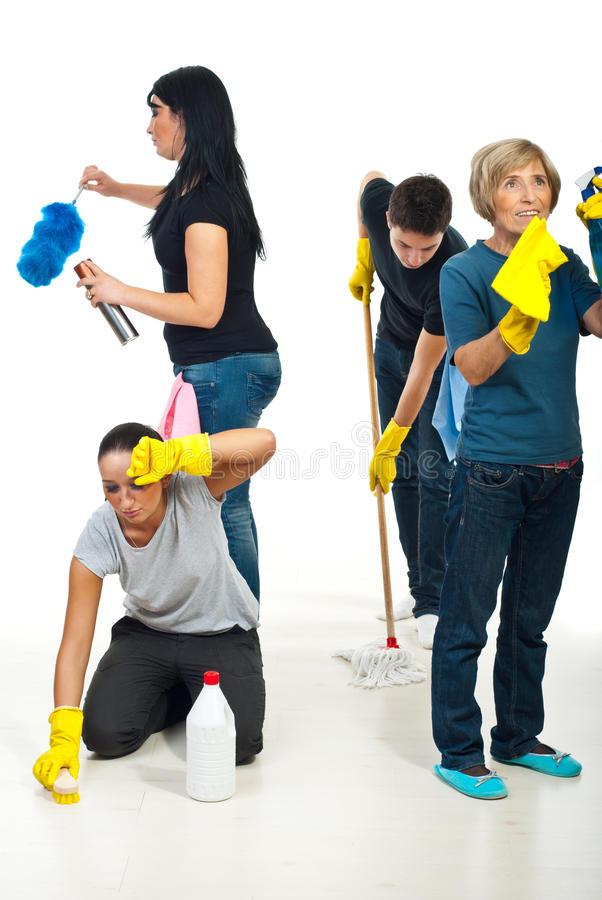 сыгранность людей дома чистки, котор нужно работать стоковые фото