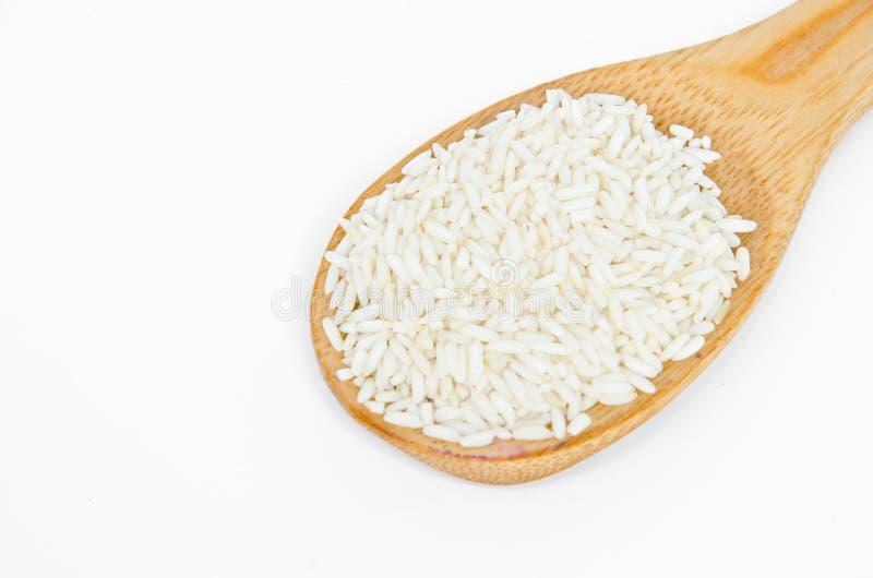 Сырцовый липкий рис в деревянной ложке стоковое изображение