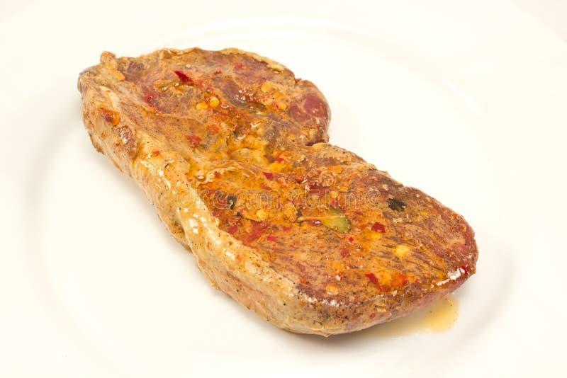 Сырцовый стейк говядины с маринадом стоковая фотография rf