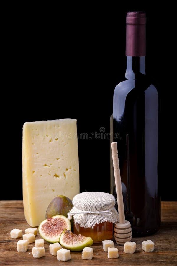Сыр и мед смоквы вина стоковые фотографии rf