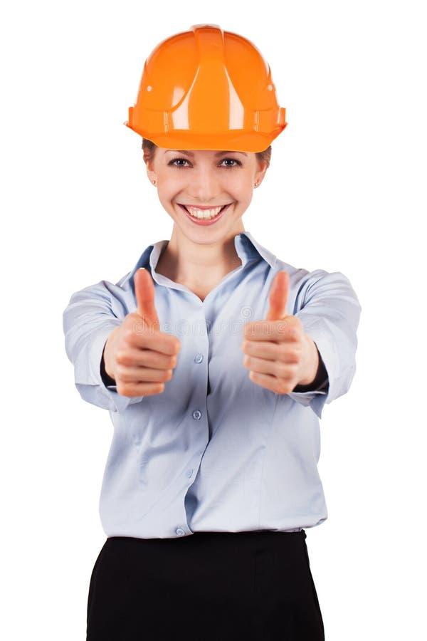 Женщина в шлеме здания защитном стоковое фото rf