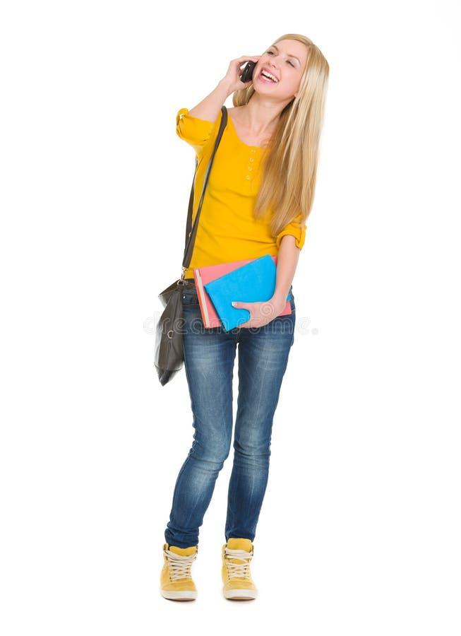 Сь мобильный телефон девушки студента говоря стоковые фото