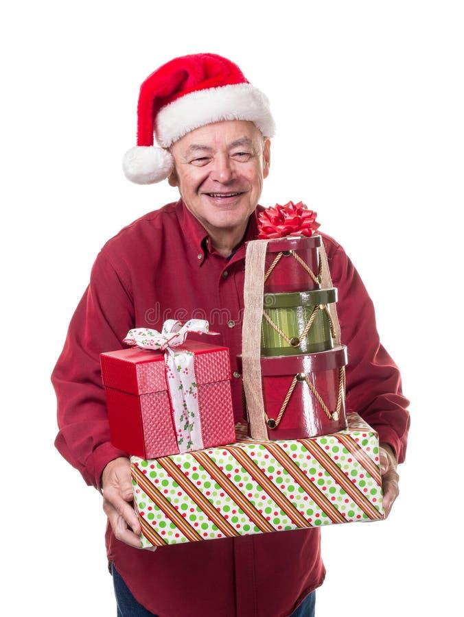 Сь счастливые подарки рождества подшипника старшего человека стоковые изображения