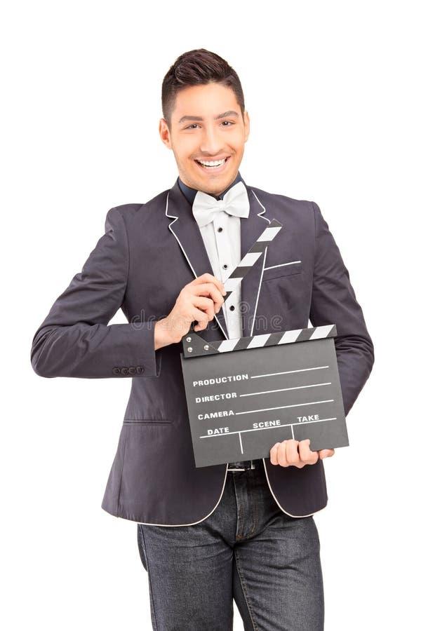 Сь человек держа хлоп кино стоковая фотография