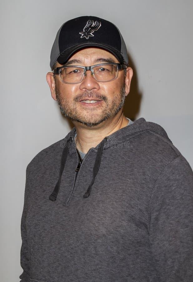 Сэм Liu на премьере царствования суперменов стоковая фотография rf