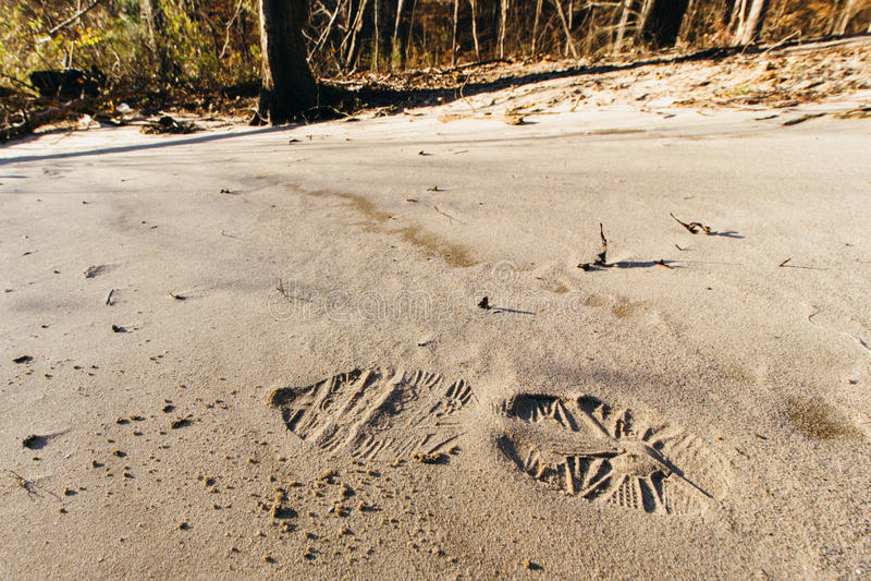 След ноги в песке стоковое фото