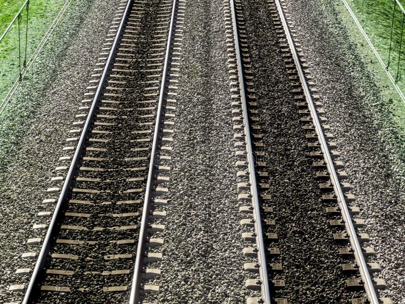 Следы ноги проходя поезда стоковое фото