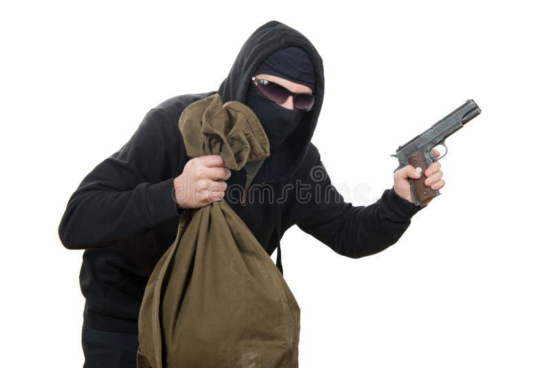 С капюшоном разбойник с сумкой денег стоковое изображение rf