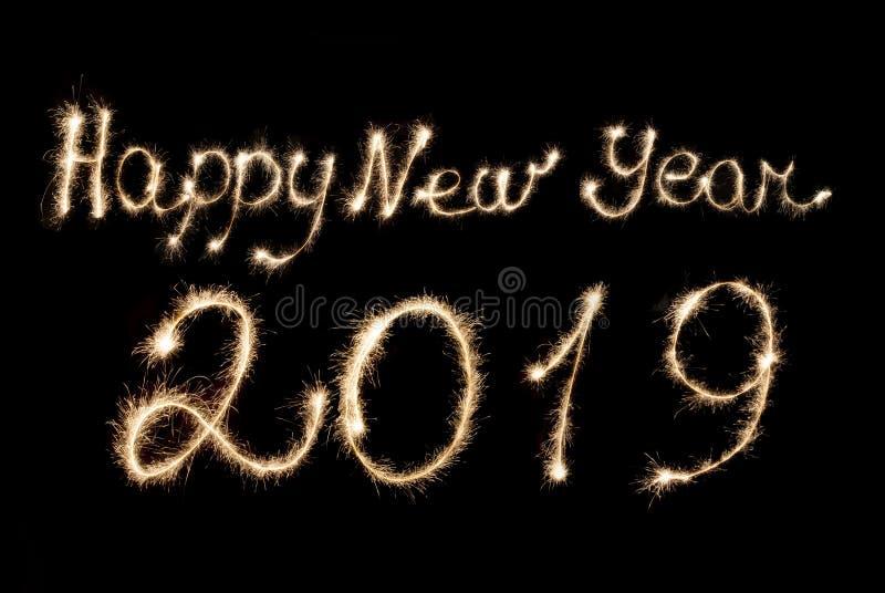 С Новым Годом! бенгальские огни 2019 надписи стоковое изображение rf