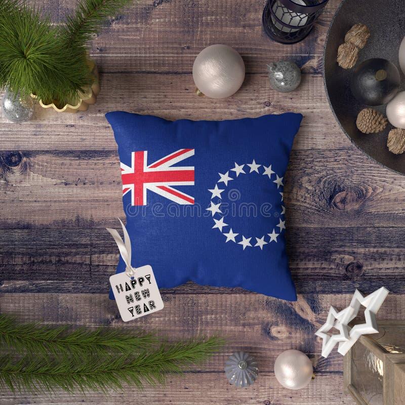С Новым Годом! бирка с Острова Кука сигнализирует на подушке r стоковая фотография