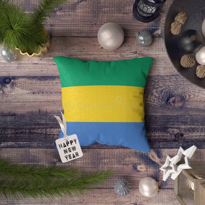 С Новым Годом! бирка с флагом Габона на подушке r стоковая фотография rf