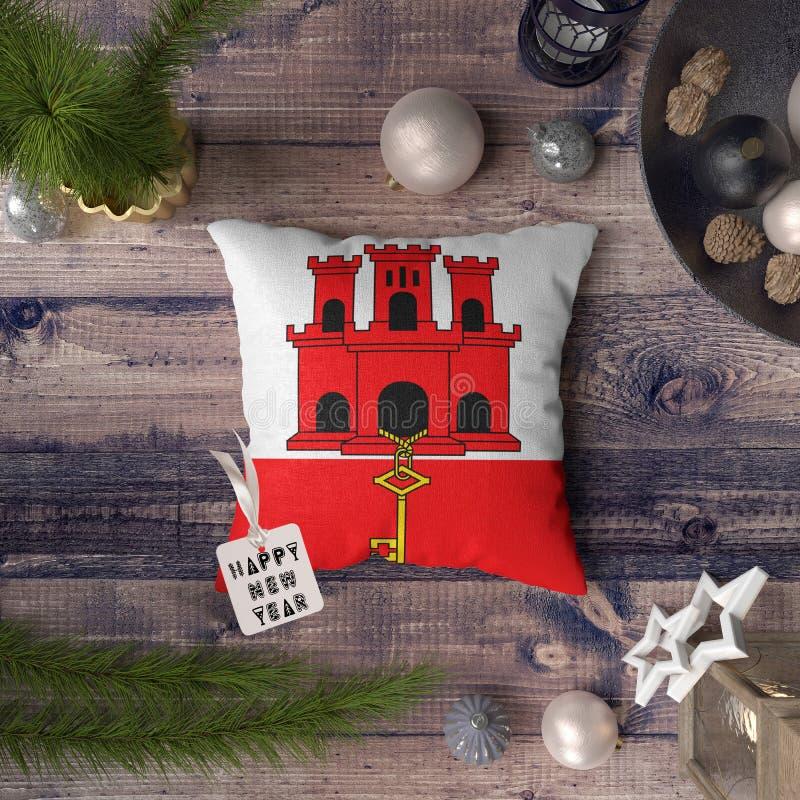 С Новым Годом! бирка с флагом Гибралтара на подушке r стоковые фотографии rf