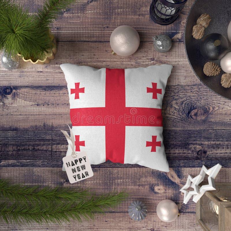С Новым Годом! бирка с флагом Грузии на подушке r стоковое фото rf