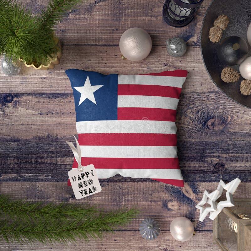 С Новым Годом! бирка с флагом Либерии на подушке r стоковое изображение rf
