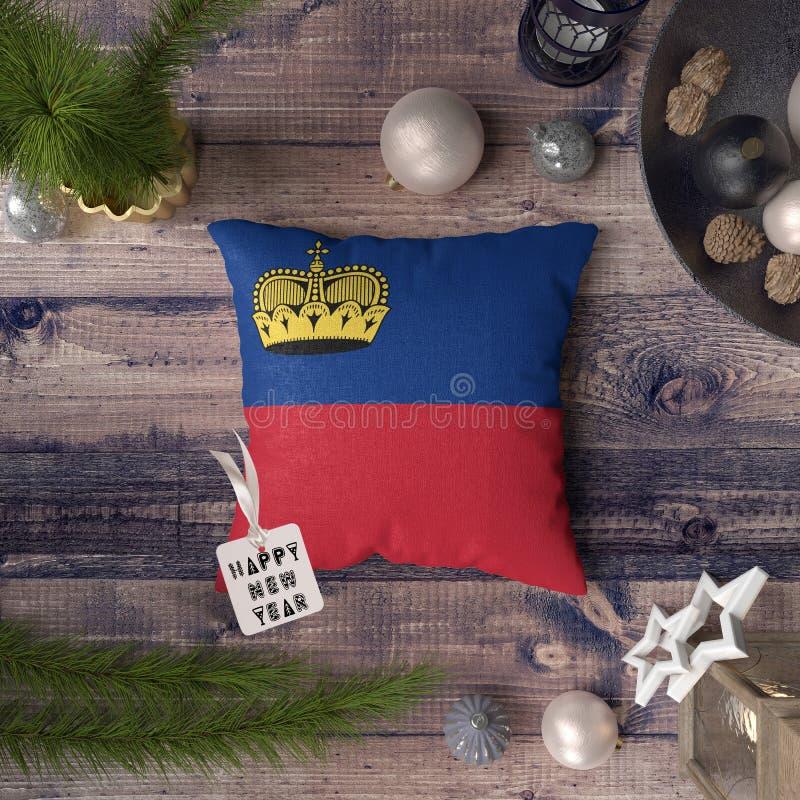 С Новым Годом! бирка с флагом Лихтенштейна на подушке r стоковая фотография rf