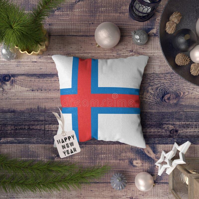 С Новым Годом! бирка с флагом Фарерских островов на подушке r стоковые изображения